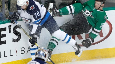 <p>               Winnipeg Jets defenseman Joe Morrow (70) and Dallas Stars center Jason Dickinson (16) hit the boards while chasing the puck during the first period of an NHL hockey game in Dallas, Saturday, Jan. 19, 2019. (AP Photo/LM Otero)             </p>