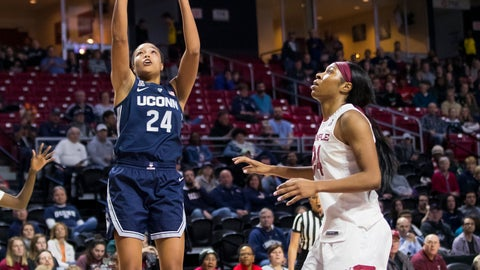 <p>               Connecticut's Napheesa Collier, center, shoots the ball with Temple's Emani Mayo, left, and Shantay Taylor, right, defending during the first half of an NCAA college basketball game, Saturday, Jan. 19, 2019, in Philadelphia. (AP Photo/Chris Szagola)             </p>