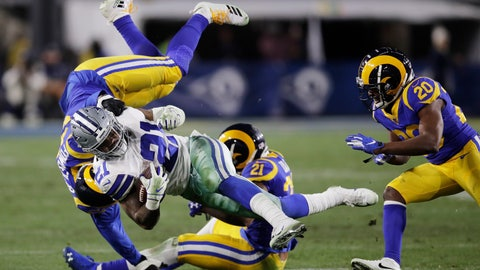 <p>               Dallas Cowboys running back Ezekiel Elliott is tackled by Los Angeles Rams linebacker Dante Fowler, top, and cornerback Aqib Talib during the second half in an NFL divisional football playoff game Saturday, Jan. 12, 2019, in Los Angeles. (AP Photo/Jae C. Hong)             </p>