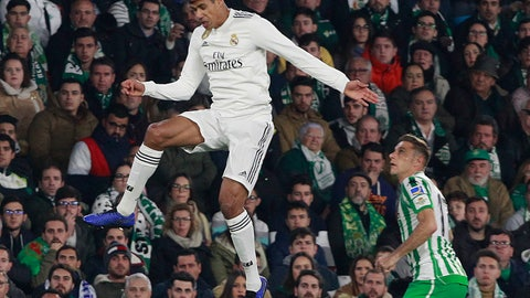 <p>               Real Madrid's Varane, left, jumps for the ball as Betis' Joaquin Sanchez looks on during La Liga soccer match at the Villamarin stadium in Seville, Spain, Sunday, Jan. 13, 2019. (AP Photo/Miguel Morenatti)             </p>