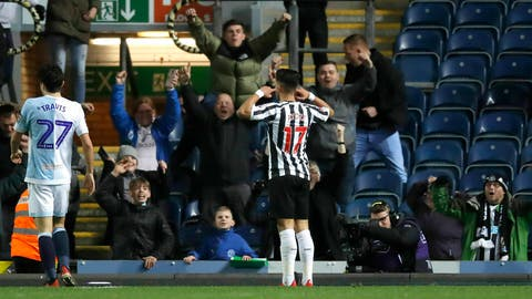 <p>               Newcastle United's Joselu celebrates scoring his side's third goal of the game during the Emirates FA Cup third round replay soccer match against Blackburn at Ewood Park, Blackburn, Tuesday Jan. 15, 2019. (Martin Rickett/PA via AP)             </p>