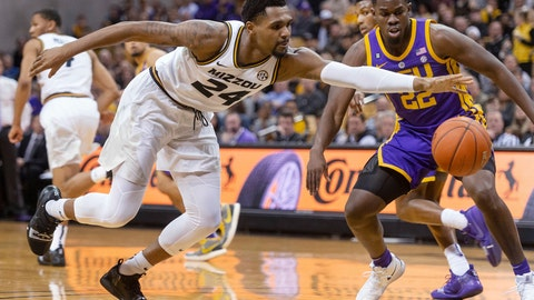 <p>               Missouri's Kevin Puryear, left, grabs a loose ball in front of LSU's Darius Days, right, during the first half of an NCAA college basketball game Saturday, Jan. 26, 2019, in Columbia, Mo. (AP Photo/L.G. Patterson)             </p>