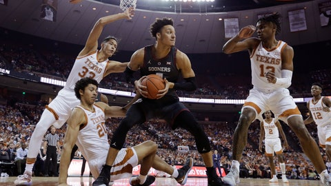 <p>               Oklahoma center Jamuni McNeace (4) grabs a rebound in front of Texas forward Kamaka Hepa (33), forward Jericho Sims (20) and guard Jase Febres (13) during the first half of an NCAA college basketball game, in Austin, Texas, Saturday, Jan. 19, 2019. (AP Photo/Eric Gay)             </p>