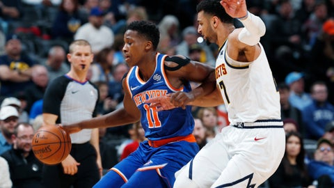 <p>               New York Knicks guard Frank Ntilikina, left, drives past Denver Nuggets guard Jamal Murray during the first half of an NBA basketball game Tuesday, Jan. 1, 2019, in Denver. (AP Photo/David Zalubowski)             </p>