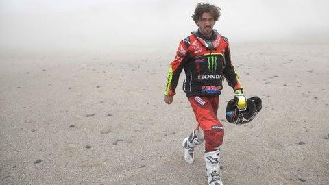 <p>               Honda motorbike rider Joan Barreda of Spain walks away after crashing during the third stage of the Dakar Rally between San Juan de Marcona and Arequipa, Peru, Wednesday, Jan. 9, 2019. (AP Photo/Ricardo Mazalan)             </p>