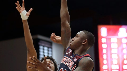 <p>               Arizona guard Justin Coleman (12) shoots over Stanford guard Bryce Wills (2) during the first half of an NCAA college basketball game in Stanford, Calif., Wednesday, Jan. 9, 2019. (AP Photo/Jeff Chiu)             </p>
