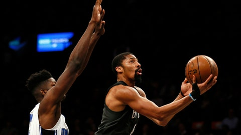 <p>               Brooklyn Nets guard Spencer Dinwiddie (8) drives to the basket past Orlando Magic center Mo Bamba during the second half of an NBA basketball game Wednesday, Jan. 23, 2019, in New York. The Nets defeated the Magic 114-110. (AP Photo/Adam Hunger)             </p>