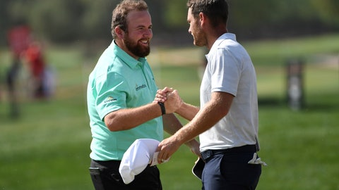 <p>               Shane Lowry, left, of Ireland shakes hands with Lucas Bjerregaard of Denmark after finishing at 10 under par on the 9th green in round one of the Abu Dhabi Championship golf tournament, in Abu Dhabi, United Arab Emirates, Wednesday, January 16, 2019. (AP/Martin Dokoupil)             </p>