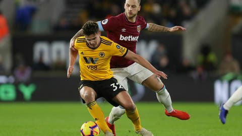 <p>               Wolverhampton Wanderers' Leander Dendoncker is challenged by West Ham's Marko Arnautovic, right, during their English Premier League soccer match at Molineux in Wolverhampton, England, Tuesday Jan. 29, 2019. (David Davies/PA via AP)             </p>