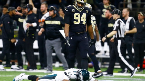 <p>               Philadelphia Eagles wide receiver Alshon Jeffery (17) lies on the turf in front of New Orleans Saints defensive end Cameron Jordan (94) after the Saints intercepted a pass in the second half of an NFL divisional playoff football game in New Orleans, Sunday, Jan. 13, 2019. The Saints won 20-14. (AP Photo/Butch Dill)             </p>