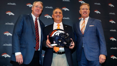 <p>               Denver Broncos new head coach Vic Fangio, center, joins team president Joe Ellis, left, and general manager John Elway for a photograph during a news conference at the team's headquarters Thursday, Jan. 10, 2019, in Englewood, Colo. (AP Photo/David Zalubowski)             </p>