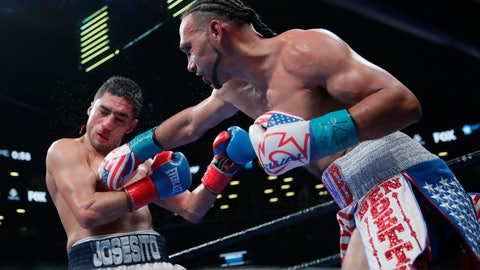 <p>               Keith Thurman, right, punches Josesito Lopez during the eighth round of a welterweight championship boxing match Saturday, Jan. 26, 2019, in New York. Thurman won the fight. (AP Photo/Frank Franklin II)             </p>