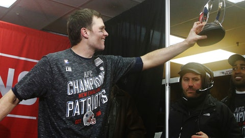 <p>               New England Patriots quarterback Tom Brady hands off the championship trophy to his teammates after the AFC Championship NFL football game against the Kansas City Chiefs, Sunday, Jan. 20, 2019, in Kansas City, Mo. (AP Photo/Charlie Riedel)             </p>