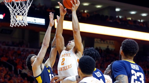 <p>               Tennessee forward Grant Williams (2) goes for a shot as he's defended by West Virginia guard Jermaine Haley (10) in the second half of an NCAA college basketball game Saturday, Jan. 26, 2019, in Knoxville, Tenn. Tennessee won 83-66. (AP Photo/Wade Payne)             </p>