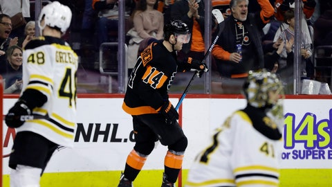 <p>               Philadelphia Flyers' Sean Couturier, center, celebrates after scoring a goal past Boston Bruins' Jaroslav Halak, right, and Matt Grzelcyk during the second period of an NHL hockey game, Wednesday, Jan. 16, 2019, in Philadelphia. (AP Photo/Matt Slocum)             </p>