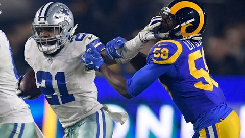<p>               Dallas Cowboys running back Ezekiel Elliott pushes off Los Angeles Rams inside linebacker Cory Littleton during the first half in an NFL divisional football playoff game Saturday, Jan. 12, 2019, in Los Angeles. (AP Photo/Mark J. Terrill)             </p>