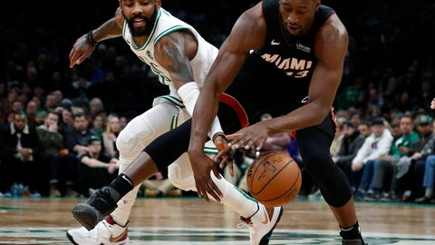 <p>               Boston Celtics' Kyrie Irving, left, reaches in to knock the ball away from Miami Heat's Bam Adebayo during the second half of an NBA basketball game Monday, Jan. 21, 2019, in Boston. (AP Photo/Winslow Townson)             </p>