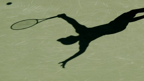 <p>               FILE - This is a 2017 file photo showing the shadow of a tennis player. Four people are in French custody on suspicion of fixing matches for an Armenian based in Belgium believed behind an illegal gambling syndicate suspected of fixing hundreds of matches. It's part of months of digging by police working across Europe to unravel a match-fixing scheme of breath-taking scale involving more than 100 players from at least half a dozen countries. Sources close to the investigation told The Associated Press that four French players were in police custody on Wednesday, Jan. 16, 2019. (AP Photo/File)             </p>