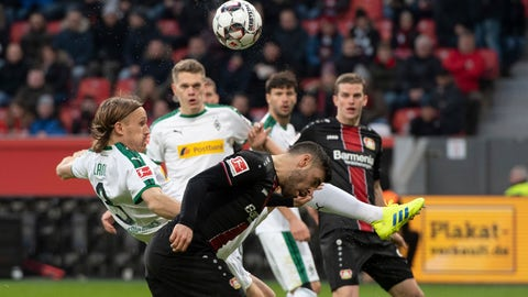<p>               Leverkusen's Kevin Volland, foreground, and Moenchengladbach's Michael Lang challenge for the ball during a German Bundesliga soccer match between Bayer Leverkusen and Borussia Moenchengladbach in Leverkusen, Germany, Saturday, Jan.29, 2019. Bernd Thissen/dpa via AP)             </p>