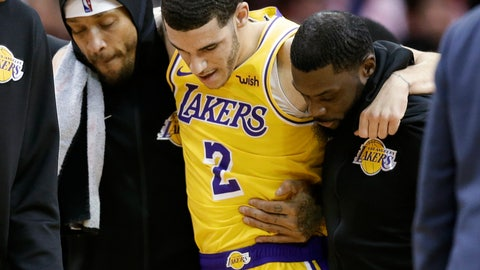 <p>               Los Angeles Lakers guard Lonzo Ball (2) is carried off the court by Michael Beasley, left, and Lance Stephenson after Ball sustained an injury during the second half of an NBA basketball game against the Houston Rockets, Saturday, Jan. 19, 2019, in Houston. (AP Photo/Eric Christian Smith)             </p>
