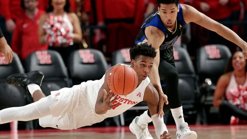 <p>               Houston guard Nate Hinton (11) falls as he passes the ball in front of Tulsa guard Zeke Moore (23) after recovering it on a scramble during the first half of an NCAA college basketball game Wednesday, Jan. 2, 2019, in Houston. (AP Photo/Michael Wyke)             </p>