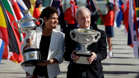 <p>               Australian tennis legends Evonne Goolagong Cawley and Rod Laver hold the women's and men's trophies, the Daphne Akhurst Memorial Cup and the Norman Brookes Challenge Cup at the official start of the Australian Open tennis championships in Melbourne, Australia, Monday, Jan. 14, 2019. (AP Photo/Aaron Favila)             </p>