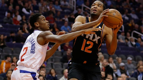 <p>               Phoenix Suns forward T.J. Warren drives past Los Angeles Clippers guard Shai Gilgeous-Alexander (2) during the second half during an NBA basketball game Friday, Jan. 4, 2019, in Phoenix. The Clippers defeated the Suns 121-111. (AP Photo/Rick Scuteri)             </p>