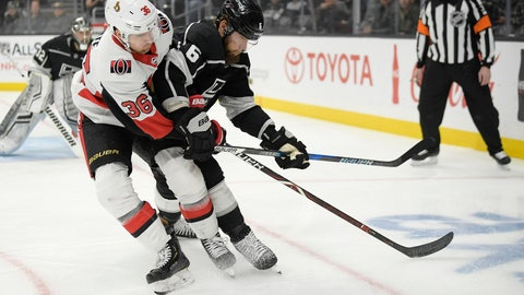 <p>               Ottawa Senators center Colin White, center, and Los Angeles Kings defenseman Jake Muzzin, right, battle for the puck as Kings goaltender Jonathan Quick watches during the first period of an NHL hockey game Thursday, Jan. 10, 2019, in Los Angeles. (AP Photo/Mark J. Terrill)             </p>