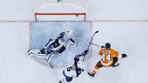 <p>               Philadelphia Flyers' Phil Varone, right, scores a goal against Winnipeg Jets' Dmitry Kulikov, center, and Laurent Brossoit during the second period of an NHL hockey game, Monday, Jan. 28, 2019, in Philadelphia. (AP Photo/Matt Slocum)             </p>