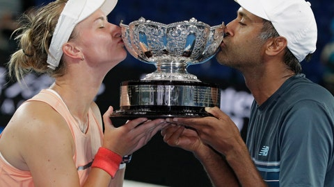 <p>               Barbora Krejcikova of the Czech Republic and United States' Rajeev Ram kiss their trophy after defeating Australia's Astra Sharma and compatriot John-Patrick Smith in the mixed doubles final at the Australian Open tennis championships in Melbourne, Australia, early Sunday, Jan. 27, 2019. (AP Photo/Aaron Favila)             </p>