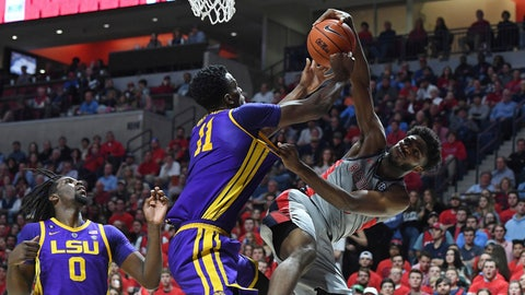 <p>               LSU forward Kavell Bigby-Williams (11) blocks a shot by Mississippi guard Blake Hinson, right, during the first half of an NCAA college basketball game in Oxford, Miss., Tuesday, Jan. 15, 2019. (AP Photo/Thomas Graning)             </p>