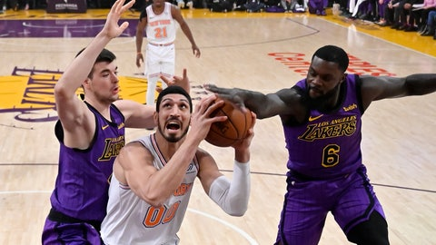 <p>               New York Knicks center Enes Kanter, center, tries to shoot as Los Angeles Lakers center Ivica Zubac, left, and guard Lance Stephenson defend during the first half of an NBA basketball game Friday, Jan. 4, 2019, in Los Angeles. (AP Photo/Mark J. Terrill)             </p>