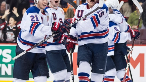 <p>               United States' Noah Cates, Mattias Samuelsson and Jason Robertson, from left, celebrate after the U.S. team defeated Russia in a world junior hockey championships semifinal in Vancouver, British Columbia, Friday, Jan. 4, 2019. (Darryl Dyck/The Canadian Press via AP)             </p>