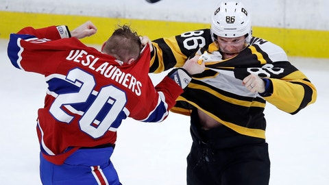<p>               Boston Bruins defenseman Kevan Miller, right, fights Montreal Canadiens left wing Nicolas Deslauriers (20) during the first period of an NHL hockey game in Boston, Monday, Jan. 14, 2019. (AP Photo/Charles Krupa)             </p>