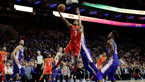 <p>               Washington Wizards' Bradley Beal, left, goes up for a shot past Philadelphia 76ers' Mike Muscala during the first half of an NBA basketball game, Tuesday, Jan. 8, 2019, in Philadelphia. (AP Photo/Matt Slocum)             </p>