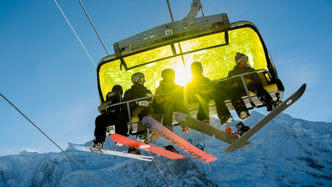 <p>               Skiers sit in a chairlift during a sunny winter day in front of the Jungfraujoch, in Wengen, Switzerland, Tuesday, Jan. 15, 2019. (Jean-Christophe Bott/Keystone via AP)             </p>