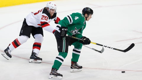 <p>               Dallas Stars defenseman Miro Heiskanen (4) and New Jersey Devils center Blake Coleman (20) skate for the puck during the second period of an NHL hockey game in Dallas, Wednesday, Jan. 2, 2019. (AP Photo/LM Otero)             </p>