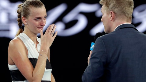 <p>               Petra Kvitova of the Czech Republic is interviewed by Jim Courier after defeating Australia's Ashleigh Barty in their quarterfinal match at the Australian Open tennis championships in Melbourne, Australia, Tuesday, Jan. 22, 2019. (AP Photo/Kin Cheung)             </p>