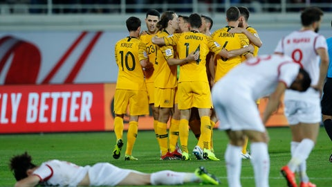<p>               Australian players, background, celebrate in the end of the AFC Asian Cup group B soccer match between Australia and Syria at the Khalifa bin Zayed Stadium in Al Ain, United Arab Emirates, Tuesday, Jan. 15, 2019. (AP Photo/Hassan Ammar)             </p>