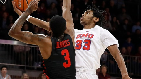 <p>               Houston guard Armoni Brooks (3) defends as SMU guard Jimmy Whitt Jr. (33) leaps to the basket for a shot in the first half of an NCAA college basketball game, Wednesday, Jan. 16, 2019, in Dallas. (AP Photo/Tony Gutierrez)             </p>