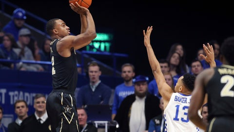 <p>               Vanderbilt's Joe Toye, left, shoots while defended by Kentucky's Jemarl Baker (13) during the first half of an NCAA college basketball game in Lexington, Ky., Saturday, Jan. 12, 2019. (AP Photo/James Crisp)             </p>