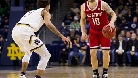 <p>               File- This Jan. 19, 2019, file photo shows North Carolina State's Braxton Beverly (10) getting  pressure from Notre Dame's Prentiss Hubb (3) during the second half of an NCAA college basketball game in South Bend, Ind. Beverly hit the last-second 3-pointer to beat Clemson for No. 23 N.C. State, which hosts No. 3 Virginia and No. 12 Virginia Tech this week. (AP Photo/Robert Franklin, File)             </p>