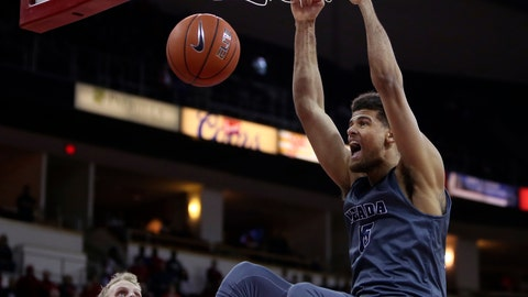 <p>               Nevada's Trey Porter, right, dunks over Fresno State's Sam Bittner during the first half of an NCAA college basketball game in Fresno, Calif., Saturday, Jan. 12, 2019. (AP Photo/Gary Kazanjian)             </p>
