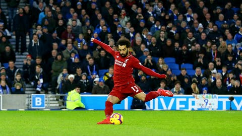 <p>               Liverpool's Mohamed Salah scores his side's first goal of the game from the penalty spot during the English Premier League soccer match between Brighton and Hove Albion and Liverpool F.C at the Vitality Stadium, Brighton England. Saturday, Jan. 12, 2019. (Gareth Fuller/PA via AP)             </p>