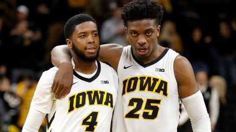 <p>               Iowa guard Isaiah Moss (4) walks off the court with teammate Tyler Cook after an NCAA college basketball game against Bryant, Saturday, Dec. 29, 2018, in Iowa City, Iowa. Iowa won 72-67. (AP Photo/Charlie Neibergall)             </p>