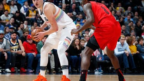 <p>               Denver Nuggets center Nikola Jokic, left, looks to pass the ball as Portland Trail Blazers forward Al-Farouq Aminu defends in the first half of an NBA basketball game Sunday, Jan. 13, 2019, in Denver. (AP Photo/David Zalubowski)             </p>