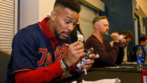 <p>               Minnesota Twins center fielder Byron Buxton autographs a bobblehead during the baseball team's TwinsFest on Friday, Jan. 25, 2019 in Minneapolis. (AP Photo/Bruce Kluckhohn)             </p>