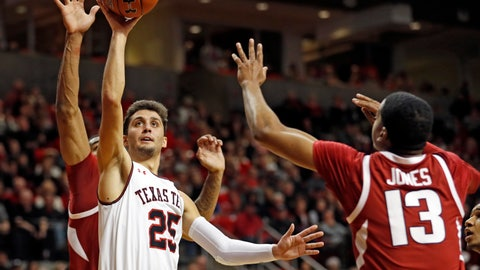 <p>               Texas Tech's Davide Moretti (25) shoots in front of Arkansas' Mason Jones (13) during the first half of an NCAA college basketball game Saturday, Jan. 26, 2019, in Lubbock, Texas. (AP Photo/Brad Tollefson)             </p>