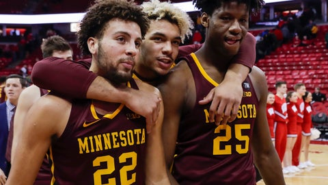 <p>               Minnesota's Gabe Kalscheur (22), Jarvis Omersa and Daniel Oturu (25) walk off the court after Minnesotan defeated Wisconsin 59-52 in an NCAA college basketball game Thursday, Jan. 3, 2019, in Madison, Wis. (AP Photo/Andy Manis)             </p>