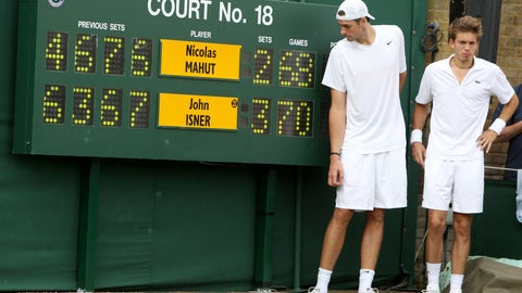 <p>               FILE - In this June 24, 2010, file photo, John Isner of the United States, left, and France's Nicolas Mahut pose for a photo next to the scoreboard following their epic men's singles match at the All England Lawn Tennis Championships at Wimbledon. The Australian Open and Wimbledon are finally doing what the U.S. Open has done for decades: figuring out a way to end a fifth set before it becomes another 26-24 slog or _ perish the thought _ 70-68. While some fans and others might still like the idea that a match could go on and on and on forever, or seemingly forever, players such as John Isner are thrilled about the change. (AP Photo/Alastair Grant, Pool, File)             </p>